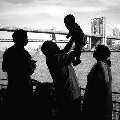 """Welcome to Your New Home!"" (antonkawasaki) Tags: nyc newyorkcity blackandwhite bw streetphotography silhouettes explore southstreetseaport brooklynbridge iphone explored welcometoyournewhome immigrantfamily antonkawasaki raisingupbabytothesky"