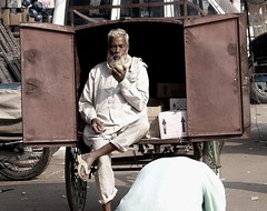 Intermission (jmanj) Tags: city people urban india cities streetphotography streetscene relaxation handcart lucknow urbanindia
