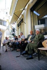Tangier Men Relaxing At A Cafe (cwgoodroe) Tags: ocean africa street old city sea summer people sun fish bus colors metal ferry plane children relax cafe sand ancient colorful doors artistic pentax vibrant muslim poor streetlife mosque arabic panasonic doorway morocco arab friendly moors conservative script casbah vegtable merchants continent merchant christians tangier monger moroccan tanger kasbah cleric sadfaces metaldoors fishmerchant casba casbha dailylifeportrait