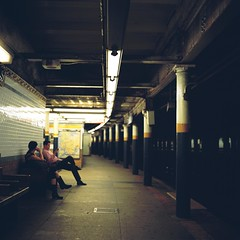 The Coming Train (Inside_man) Tags: people newyork reflection texture 120 6x6 tlr film colors mediumformat subway colorful minolta bokeh manhattan columns citylife fluorescent rhythmic autocord portravc minoltaautocord thecomingtrain