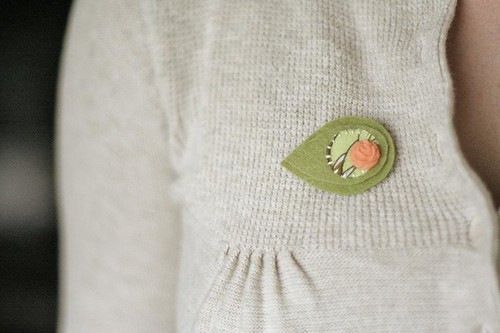 green felt pin.