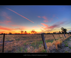 Like a Shooting Star :: HDR (:: Artie | Photography ::) Tags: sunset red sky field clouds photoshop canon bravo cs2 farm tripod fences australia wideangle newsouthwales grasses poles 1020mm flaming hdr artie waggawagga 3xp sigmalens photomatix tonemapping tonemap 400d rebelxti