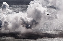 Helicopter from a Helicopter (Rod the Rabid Rodent) Tags: ocean shadow water movie vent volcano hawaii lava flying tour action saveme7 deleteme10 smoke fake scene aerial steam helicopter bigisland kilauea magma thepinnacle 3x2 d90 kīlauea 105mmf28gvrmicro youvsthebest rtrr 10to7 thepinnaclehof