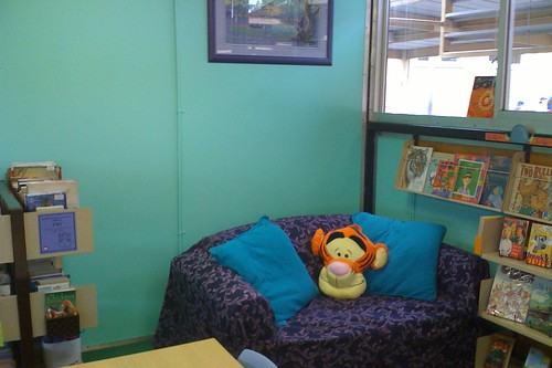 purple couch, Tigger, green wall