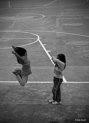 Jump! (Inkblots) Tags: portrait people girl monochrome child play action philippines olympus 100 sagada scenes zuiko filipinochild dingfuellos thefilipinochild larawangpinoy wowpilipinas inkblots