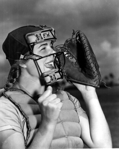 Dottie Schroeder, catcher, shouting play ball behind mask