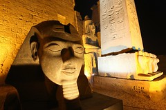 The Pharaohs of Luxor (... Arjun) Tags: africa light 15fav monument statue architecture night 1025fav 510fav temple nightshot egypt 100v10f noflash unescoworldheritagesite worldheritagesite egyptian obelisk pharaoh f56 luxor 2009 thebes mut ramsesii amun pharaohs 17mm luxortemple khonsu amenhotepiii bluelist iso2000 canoneos5dmarkii canonef1740mmf4lisusm canon5dmarkii southernsanctuary