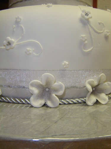 side view of silver floral wedding cake