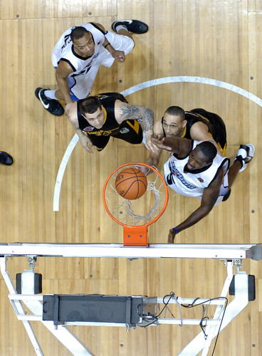 Action Under the Basket.  Photo by Chuck Miller.