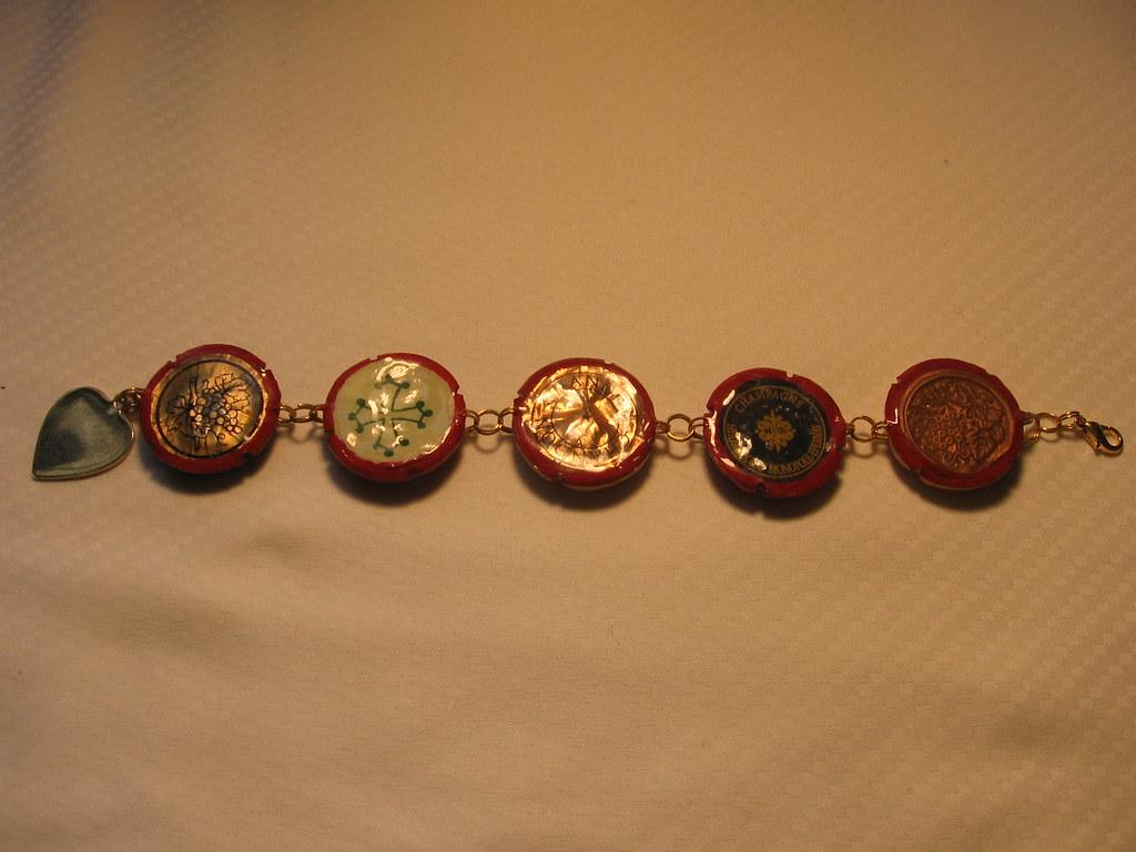 Five cap bracelet with heart dangle - back