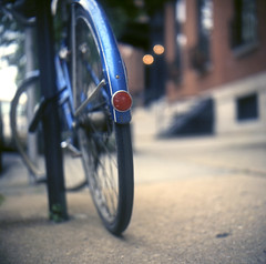 lucky blue (patrickjoust) Tags: street city urban usa color tlr film bike closeup america lens prime us reflex focus flickr fuji mt with bokeh united patrick twin maryland slide baltimore mount mat v chrome 124g epson states manual rap 500 expired 80 joust vernon fujichrome e6 yashica 220 estados astia bicylce 80mm 100f f35 reversal unidos yashinon spiratone v500 autaut lovelycity patrickjoust