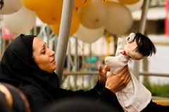 puppet hug (hapal) Tags: street girl face book hands hug iran emotion puppet fair scowl iranian tehran           canoneos40d hamidnajafi