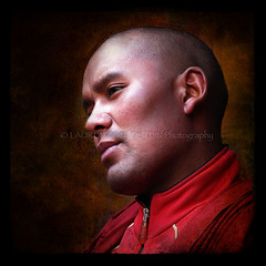 A Beautiful Soul (designldg) Tags: travel red portrait people india man eye closeup temple freedom asia peace friendship emotion expression buddhist faith religion handsome trumpet atmosphere happiness monk buddhism panasonic human soul tibetan tradition spiritual shanti leh chiaroscuro freetibet ladakh humility hemis theface clairobscur  corporeal indiasong dmcfz18