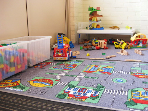 Playroom with fun rug and storage