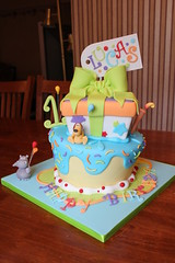 Hippo and Dog wonky party cake (Andrea's SweetCakes) Tags: balloons stars candle sprinkles birthdaycake bow present gifttag drippyicing hippoanddog