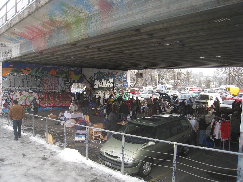 Flea market under a graffiti'd bridge