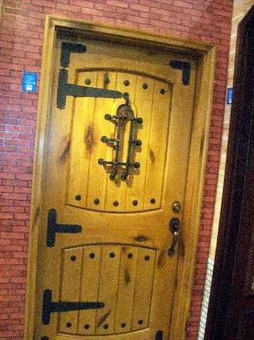 Reclaimed wood used to build custom Wine Room Doors
