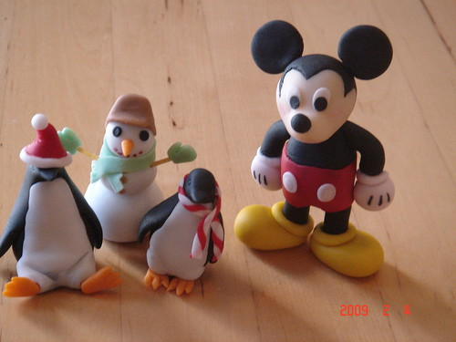 Mickey mouse and penguins fondant figures