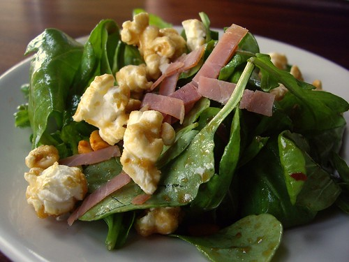 "Farm Stand Arugula ""Cracker Jack"" Salad with Country Ham, Caramel Corn, Spicy Peanuts, Buttermilk Blue, and Apple Cider Vinaigrette"