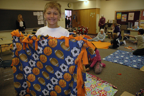 Blake Snyder holds up one of the blankets made by the students at White Lick Elementary
