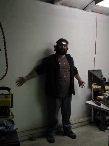 me in an empty garage spot once occupied by large wooden boards