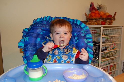 Feeding himself with a spoon 2
