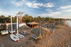 Sharm El Sheikh. Naama Bay. (WomEOS) Tags: sky holiday beach sunrise boat redsea egypt sharmelsheikh palmtrees 2009 naamabay sharmelshaikh  hiltonfayrouz hiltondreams