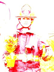 Hats off to firefighters (nightshooter09) Tags: flowers red portrait hat yellow youth student volunteer firefighter idealism theworldwelivein peopleinmyneighborhood blindphotographers juniorfirefighter inspiringstory