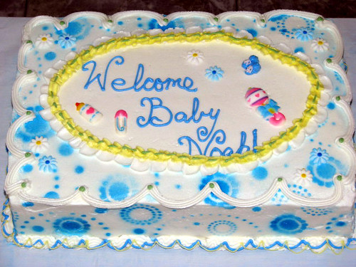 This Giant Eagle cake design is offered in all three sheet cake sizes and features icing roses and a pair of plastic baby booties. There is room in the middle to add a greeting. The cost of this cake is usually the same as the starting Giant Eagle cake prices shown above.