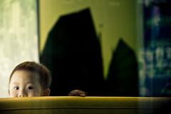 Shy Boy (jk+too) Tags: street boy glass restaurant kid cafe shy