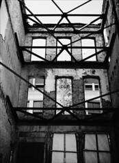 Behind the Facade (Jamie Powell Sheppard) Tags: blackandwhite bw art 120 film architecture facade mediumformat photo downtown kentucky fineart louisville mf mainst demolished kodaktrix400 mamiya645protl femalephotographer hc110dilb 25redfilter 80mmlens