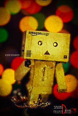 Saving Private Danbo   *Explored* (achew *Bokehmon*) Tags: old red texture wet water rain circle paper private army war bokeh ryan sony droplet saving alpha ragged a300 danbo danboard  danbowallpaper danboardwallpaper