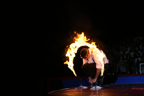 In his Ringling Circus Debut, Justin Case Rides a Tiny Bike through a Ring of Fire. Opening Night Performance of Coney Island Boom A Ring Circus. Photo © Pablo57 via flickr