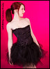Profile of red headed model in cute ponytail, black corset and black tutu. Model: MM 2097186