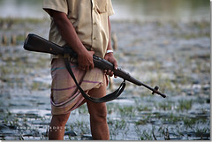 Sundarbans Forest Guard (Shabbir Ferdous) Tags: portrait gun photographer mud rifle bangladesh no5 bangladeshi mk1 canoneos5d sundarbans ef70200mmf28lisusm20x forestguard shabbirferdous wwwshabbirferdouscom shabbirferdouscom