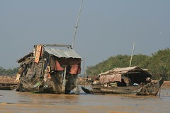 Houseboats (Infidelic) Tags: people lake season boat cambodia houseboat rainy sap tonlesap tonle tonlesaplake