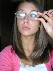 Cute brunette girl pushes up her glasses (GwG Fan) Tags: pink pose glasses brunette cardigan nailvarnish girlswithglasses whiteblouse pinktop girlwearingglasses gwgs pushthemup