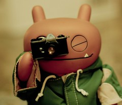 """Click"" (Photo David) Tags: wage toy toys vinyl critterbox uglydoll uglydolls horvath nikon nikkor 365toyproject orange monster apron d300 50mm 14 camera self portrait cinnamon rose presets"