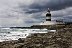Hook Head Lighthouse (Pockets1) Tags: ireland sea lighthouse seascape jason tower water bulb warning canon lens coast town rocks surf waves stripes coastal breakers flashing 1785mm beacon wexford 2009 hookhead  40d pockets1 jasontown