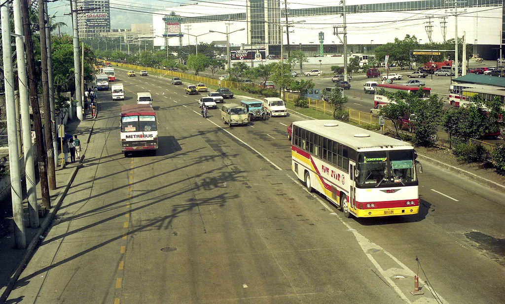 Five Star Hino RF NXS-138 (fleet No 1768) and Metrobus Nissan Diesel in EDSA, Mandaluyong, Manila, Philippines.