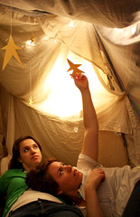 Juli and Eileen (smwright) Tags: girls stars bedroom reaching fort sheets christmaslights resting