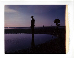take a picture (Rhiannon Adam) Tags: sunset beach liverpool polaroid sculture crosby wirral expiredfilm anthonygormley 600se anotherplace crosbybeach instantpicture 180camera