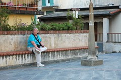 Mom Sitting Near The Church of San Lorenzo (Crumblin Down) Tags: plaza sunset sea vacation italy holiday love church water colors clouds train coast town italian colorful mediterranean italia catholic colours roman small hike via dell terre colourful piazza vernazza amore manarola cinque corniglia tyrrhenian