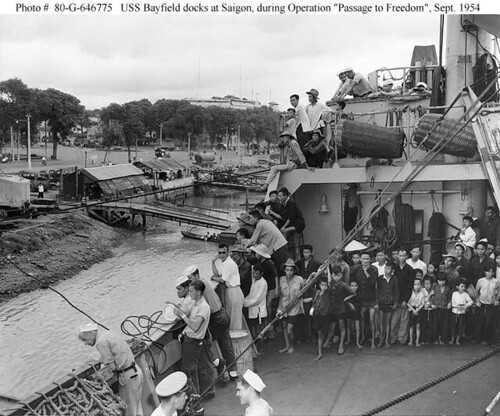 USS Bayfield (APA-33) docks at Saigon, Indochina, to offload refugees following a trip from Haiphong, September 1954. by VIETNAM History in Pictures (up to 1954).