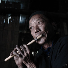 Time to play (NaPix -- (Time out)) Tags: portrait music man black 6x6 face square asia spirit flute bamboo vietnam explore soul emotions sapa hmong 500x500 explored explorefrontpage napix canoneosdigitalrebelxsi winner500
