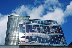 Windows 09 (habeebee) Tags: city blue sky urban reflection building london architecture clouds shiny hammersmith offices sunstar