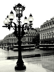 Paris in the Rain (Kurlylox1) Tags: paris streets wet buses rain buildings reflections lights opera pavement lamppost lamps avenue garnier cafedelapaix ilpleut legrandhotel whydoesitalwaysraininparis