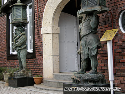 A foreign house with two oriental statues outside
