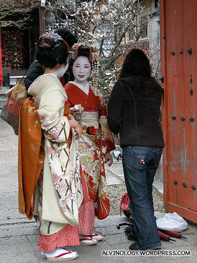 Geishas getting dressed