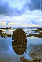 The stone reflection (Maaar) Tags: sunset bali seascape reflection beach landscape stones echobeach canggu img2930 helivesinyouhelivesinmehewatchesovereverythingweseeintothewaterintothetruthinyourreflectionhelivesinyou